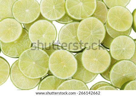 Stock picture of sliced limes on a white background - stock photo