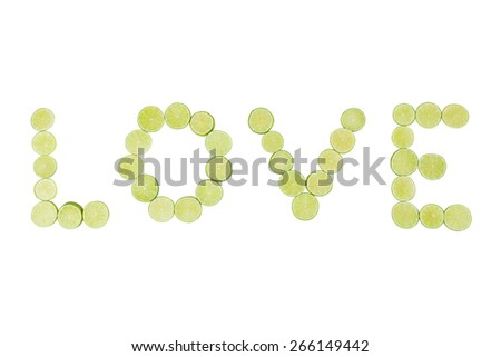 Stock picture of sliced limes spelling the word love - stock photo
