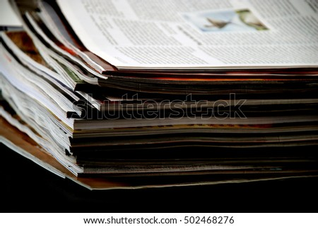 stock pictures of a stack of newspapers or magazines
