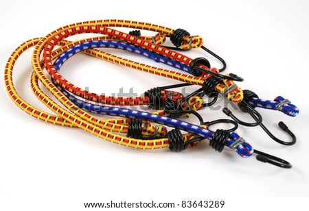 Stock pictures of bungee cords with steel hooks of several colors - stock photo