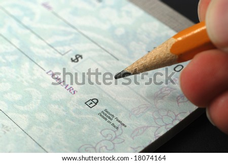 Stock pictures of checks used as a form of payment - stock photo