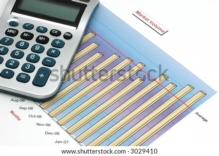 Stock Report with Calculator - stock photo