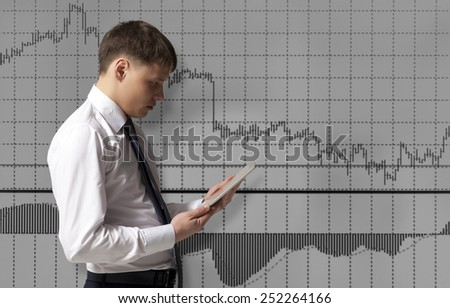 Stock trader looking at tablet computer in office - stock photo