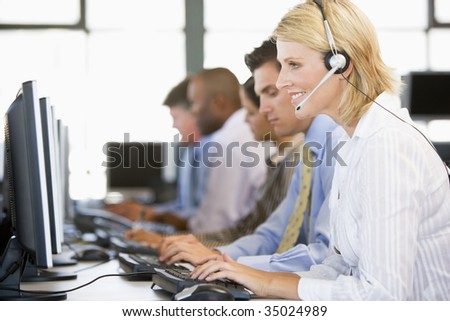 Stock Traders With Headsets At Work