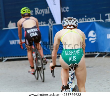 STOCKHOLM - AUG 23, 2014: Charlotte McShane (AUS) and Chelsea Burns (USA) cycling in the Women's ITU World Triathlon series event August 23, 2014 in Stockholm, Sweden - stock photo