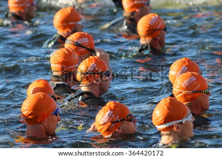 STOCKHOLM - AUG 23, 2015: Close-up of group of male swimmers wearing orange swimming caps at ITU World Triathlon event in Stockholm, 2015 - stock photo