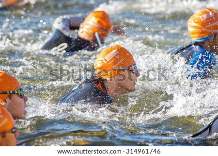 STOCKHOLM - AUG 23, 2015: Closeup of a male triathlete smimming at ITU World Triathlon event in Stockholm. - stock photo
