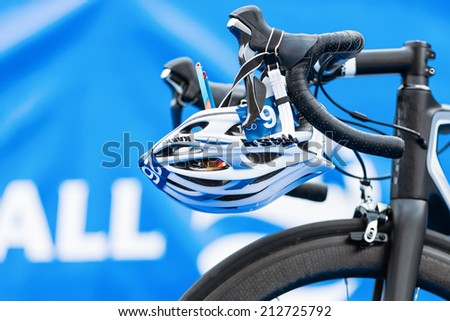 STOCKHOLM - AUG, 23: Closeup of helmet and triathlon bike gear in the transition zone at the Mens ITU World Triathlon Series event Aug 23, 2014 in Stockholm, Sweden - stock photo