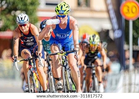 STOCKHOLM - AUG 22, 2015: Lotte Miller (NOR) drinking water at the Womens ITU World Triathlon series event in Stockholm. - stock photo