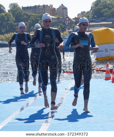 STOCKHOLM - AUG 22, 2015: Many female swimmer climbing up from the water in the Women's ITU World Triathlon series event August 22, 2015 in Stockholm, Sweden - stock photo
