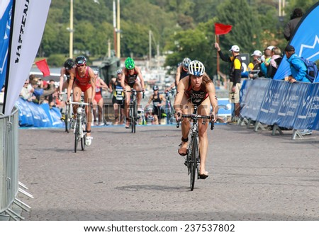 STOCKHOLM - AUG 23: Sarah Groff in the lead after the transition in the Women's ITU World Triathlon series event August 23, 2014 in Stockholm, Sweden - stock photo