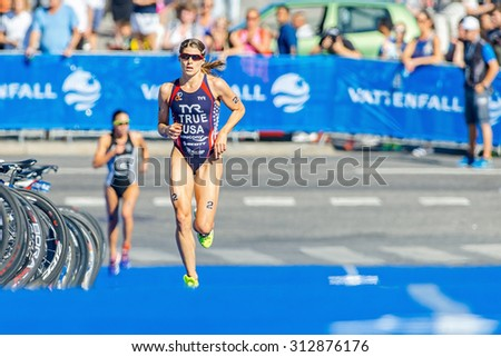 STOCKHOLM - AUG 22, 2015: Winner Sarah True (USA) followed by Andrea Hewitt (NZL) at the Womens ITU World Triathlon series event in Stockholm.
