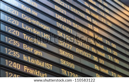 STOCKHOLM - AUGUST 06: Flight board in Arlanda airport, on August 6, 2012 in Stockholm, Sweden. This is the largest airport is Sweden, with throughput exceeding 19 million passengers per year - stock photo