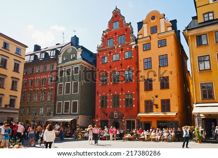 STOCKHOLM - AUGUST 18, 2011 - medieval Stortorget square in Stockholm, Sweden. Tourists visiting the sights of Stockholm and relax in the outdoor cafes and restaurants. - stock photo