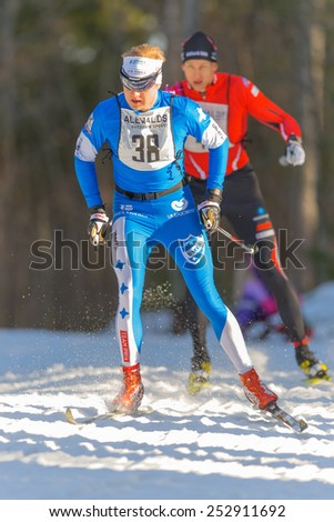STOCKHOLM - FEB 15: The leader Robin Norum from Umea after the second lap in the Stockholm ski marathon in cross country skiing, february 15, 2015 in Stockholm, Sweden. Stockholm Ski Marathon 46 km - stock photo