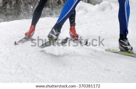 STOCKHOLM - JAN 24, 2016: Close up of speedy colorful skies, feet and legs of a cross country skier at the Stockholm Ski Marathon event January 24, 2016 in Stockholm, Sweden - stock photo