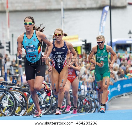 STOCKHOLM - JUL 02, 2016: Claire Michel (BEL) and group of colorful triathletes running in the transition zone in the Women's ITU World Triathlon series event July 02, 2016 in Stockholm, Sweden