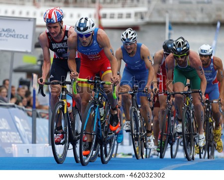 STOCKHOLM - JUL 02, 2016: Large group of male triathlete cyclists, Alistair Brownlee and competitors in the trasition zone in the Men's ITU World Triathlon series event July 02,2016,Stockholm,Sweden