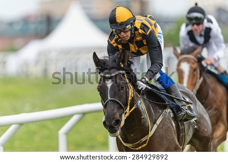 STOCKHOLM - JUNE 6: Closeup of a jockeys and horses eyes during race at the Nationaldags Galoppen at Gardet. June 6, 2015 in Stockholm, Sweden. - stock photo
