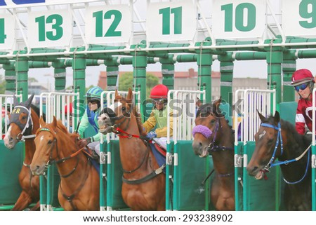 STOCKHOLM - JUNE 06: The start in the horse race at the Nationaldags Galoppen at Gardet. June 6, 2015 in Stockholm - stock photo
