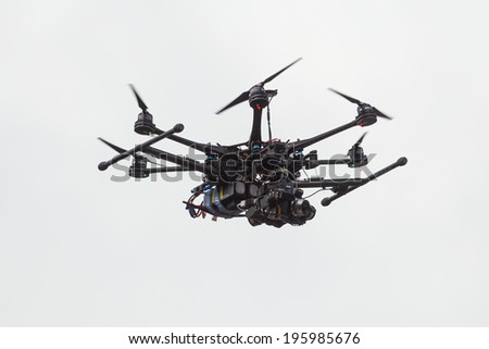 STOCKHOLM - MAY 31: Camera drone hovering above the runners at ASICS Stockholm Marathon 2014. May 31, 2014 in Stockholm, Sweden. - stock photo