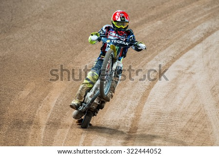 STOCKHOLM - SEPT 26, 2015: Chris Holder from the USA celebrates the heat victory with a wheelie on the TEGERA Stockholm FIM Speedway Grand Prix at Friends Arena in Stockholm. - stock photo