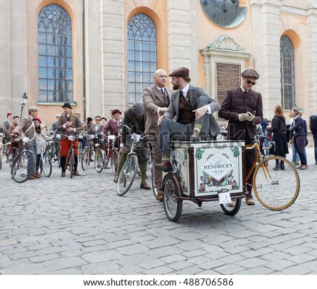 STOCKHOLM - SEPT 24, 2016: Man sitting on a cycle used by gophers wearing old fashioned brown tweed clothes in the Bike in Tweed event September 24, 2016 in Stockholm, Sweden