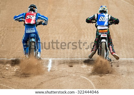 STOCKHOLM - SEPT 26, 2015: Two speedway racers starting at one of the heats at the TEGERA Stockholm FIM Speedway Grand Prix at Friends Arena in Stockholm. - stock photo