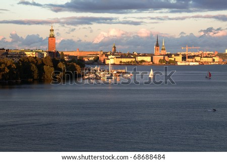Stockholm skyline at sunset, copy space on sky and sea - stock photo