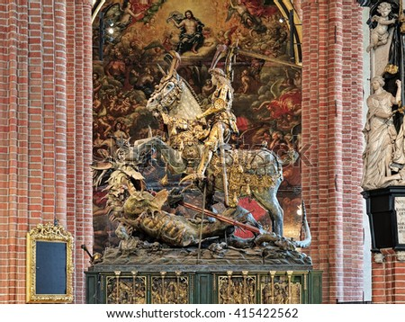 STOCKHOLM, SWEDEN - APRIL 3, 2016: Saint George and the Dragon, an extremely well-preserved wooden sculpture in Storkyrkan (The Great Church). It was created by Bernt Notke from Lubeck in 1489. - stock photo