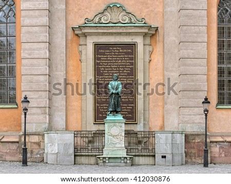 STOCKHOLM, SWEDEN - APRIL 3, 2016: Sculpture of Olaus Petri, a Swedish Protestant Reformer, in front of Stockholm Cathedral. The statue by the Swedish sculptor Theodor Lundberg was unveiled in 1898.