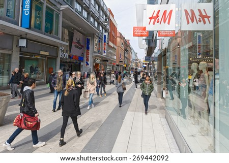 STOCKHOLM, SWEDEN - APRIL 8: The most popular shopping street at Drottningatan in Stockholm, April 8, 2015 in Stockholm, Sweden. - stock photo