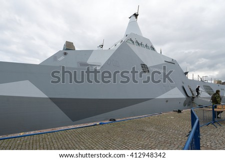 STOCKHOLM, SWEDEN - APRIL 23, 2016: Two military stealth corvettes in the Visby class embarked in Stockholm. HMS Harnosand and Nykoping. - stock photo