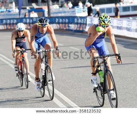 STOCKHOLM, SWEDEN - AUG 23, 2015: Swedish triathlete Gabriel Sandor cycling and drinking water in the Men's ITU World Triathlon series event August 23, 2015 in Stockholm, Sweden - stock photo