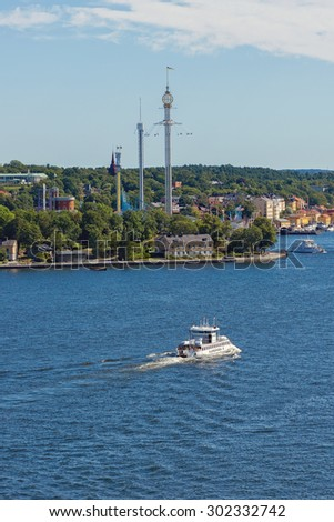 STOCKHOLM, SWEDEN - AUGUST 1, 2015: Above view of the recrational area Djurgarden with Grona lund and Skansen with passenger ferries in traffic. - stock photo