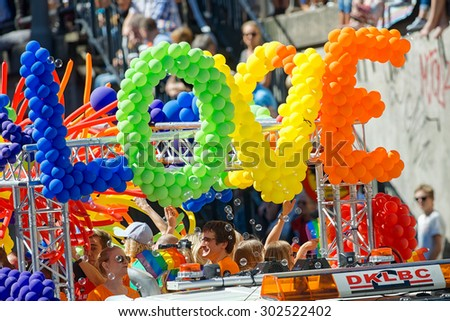 STOCKHOLM, SWEDEN - AUGUST 1, 2015: Big baloon love sign at the Pride parade in Stockholm. Approx 400.000 spectators at the streets. - stock photo