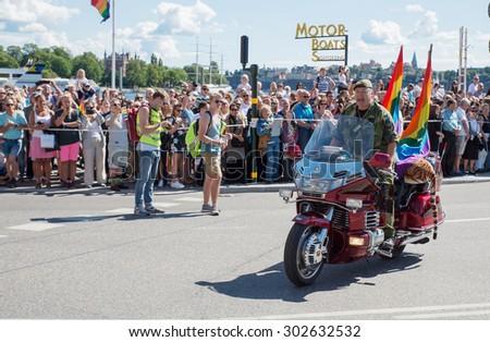 STOCKHOLM, SWEDEN - AUGUST 1: Unidentified participants during the Stockholm pride festival parade on August 1, 2015 in Stockholm Sweden - stock photo