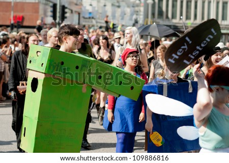 STOCKHOLM, SWEDEN - AUGUST 4: Woman in green box marching at Stockholm Pride Parade on August 4, 2012 in Stockholm which attracts an estimated 50000 participants and 500000 spectators. - stock photo