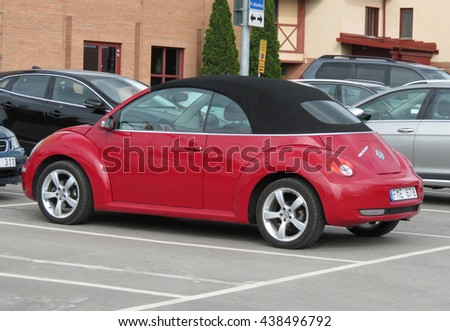 STOCKHOLM, SWEDEN - CIRCA JUNE 2016: red Volkswagen New Beetle cabrio car parked in a street of the city centre - stock photo