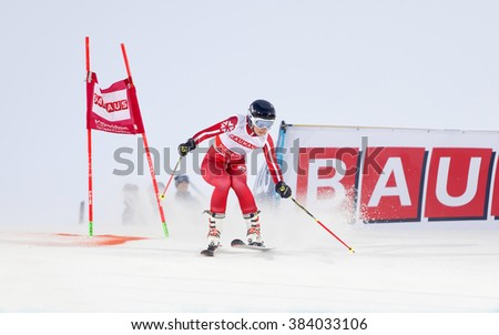 STOCKHOLM, SWEDEN - FEB 23, 2016: One female skiier in red at the FIS Alpine Ski World Cup - city event February 23, 2016, Stockholm, Sweden
