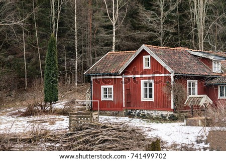 STOCKHOLM, SWEDEN - FEBRUARY 7, 2017: Classic Swedish wooden red house as a place for living in the forest as seen in Stockholm, Sweden