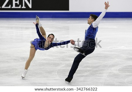 STOCKHOLM, SWEDEN - JANUARY 30, 2015: Nicole DELLA MONICA / Matteo GUARISE of Italy perform during pairs short program at ISU European Figure Skating Championship in Globen Arena.