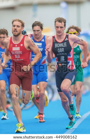 STOCKHOLM, SWEDEN - JULY 02, 2016: Alistair Brownlee in a group at the transition to running at the Mens ITU Triathlon event in Stockholm. - stock photo