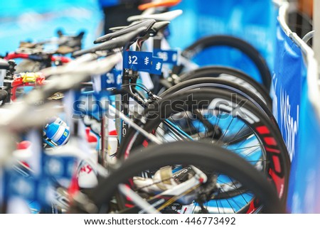 STOCKHOLM, SWEDEN - JULY 02, 2016: Details of bikes at the bikestand at the transition area at the Women ITU Triathlon event in Stockholm. - stock photo