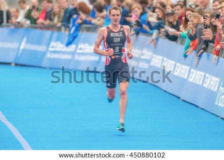 STOCKHOLM, SWEDEN - JULY 02, 2016: Winner Alistair Brownlee running to the finish line at the Mens ITU Triathlon event in Stockholm.