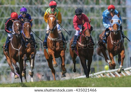 STOCKHOLM, SWEDEN - JUNE 6, 2016: Jockeys and horses side by side at the Nationaldags Galoppen at Gardet.