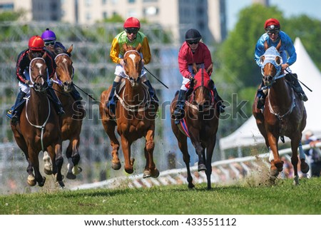 STOCKHOLM, SWEDEN - JUNE 6, 2016: Racehorses with jockeys at the Nationaldags Galoppen at Gardet.