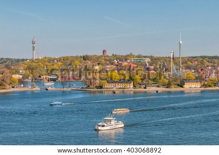 STOCKHOLM, SWEDEN - MAY 1: Aerial view from Katarina elevator of Djurgarden on May 1, 2009 in Stockholm. Djurgarden is a recreational area with several museum, a zoo and an amusement park. - stock photo