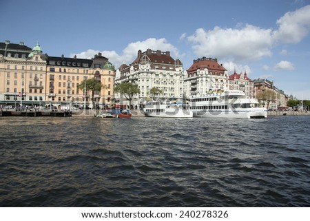 STOCKHOLM, SWEDEN - MAY 7, 2012: Architecture in the center of Stockholm, Sweden. Stockholm is the capital of Sweden and the most populous city in Scandinavia, and a popular touristic destination - stock photo