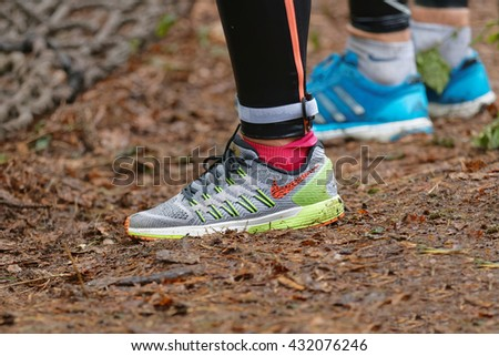 STOCKHOLM, SWEDEN - MAY 14, 2016: Closeup of sport shoe before climbing up a net in the obstacle race Tough Viking Event in Sweden, May 14, 2016